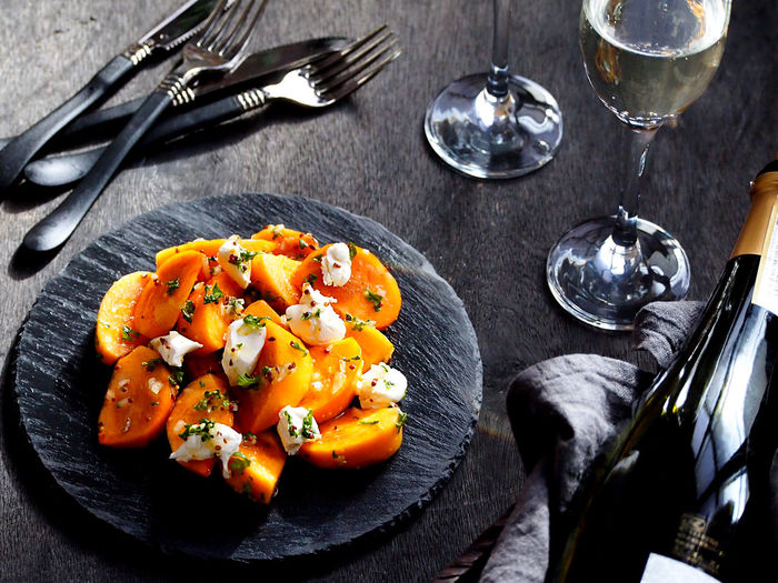 Spiced Persimmon & Cream Cheese Salad Food And Drink Food Freshness Healthy Eating Table Wellbeing Close-up High Angle View Fruit Food And Drink Wine Salad Fork Glass Food And Drink