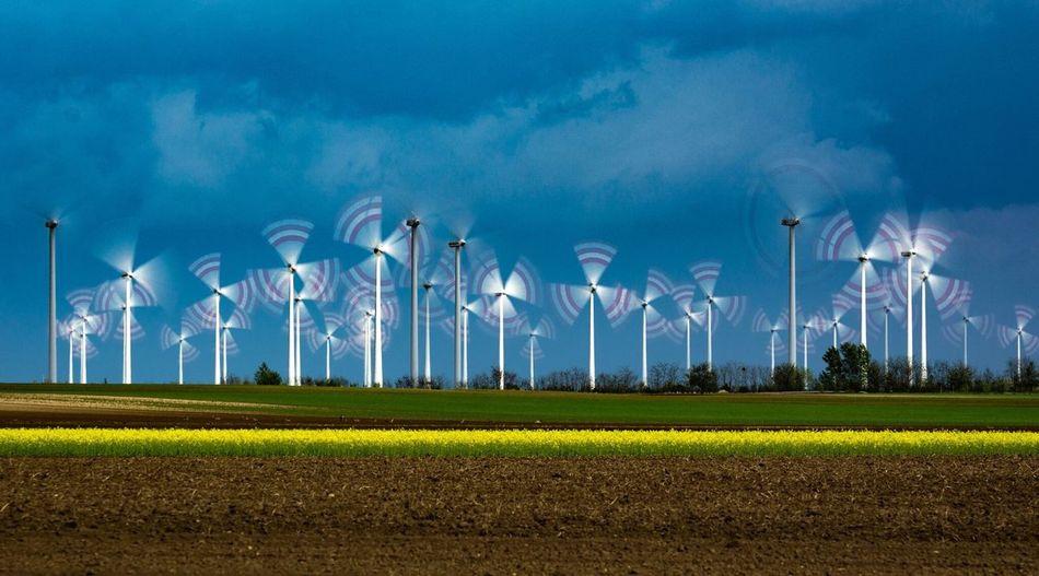 Windmills against blue sky
