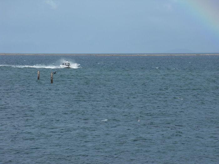 Rush to Fishing Olympic Peninsula Strait Of Juan De Fuca Bay Boat Boat In The Distance Boat In Water Fishing Boat Lone Boat Ocean Rainbow Speeding Boat