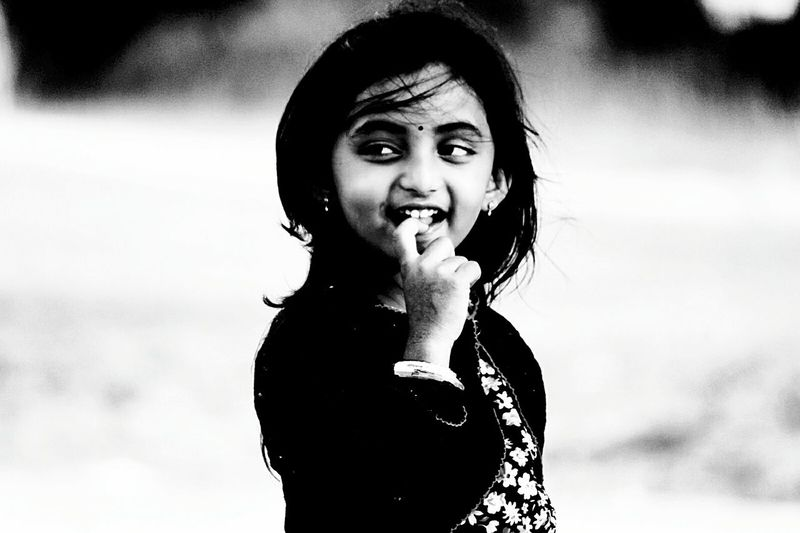 Cute girl with finger in mouth