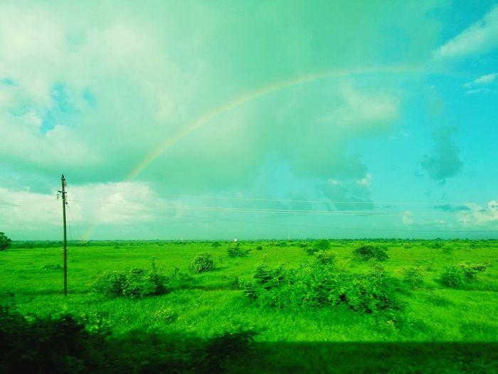 Rainbow from train Rural Scene Agriculture Field Rainbow Sky Green Color Cloud - Sky Landscape