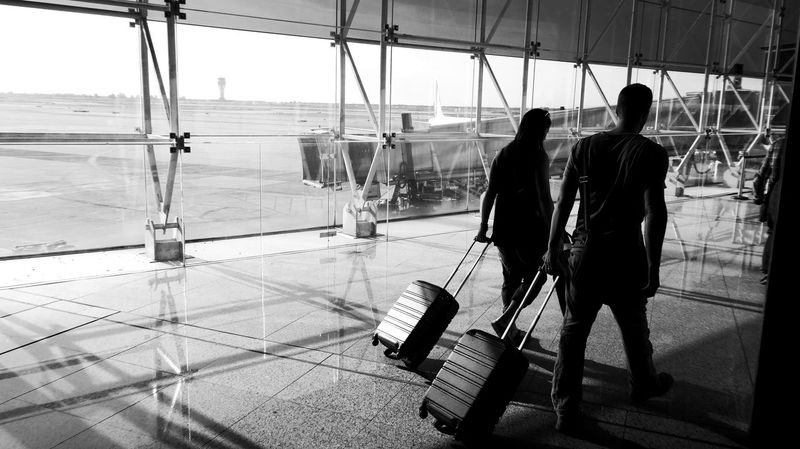 Going to fly Two People Walking Adult People Real People Day Togetherness Lifestyles Occupation Outdoors EyeEm Gallery Let's Go Smarter Vacations Travel Architecture Reflections Fly Away Trolleys Trolley Light And Shadow Black And White EyeEm Selects