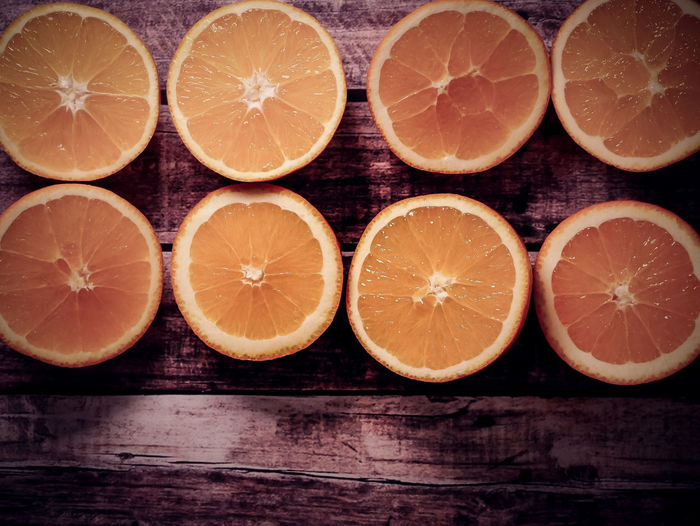 Citrus Fruit Healthy Eating Fruit Food And Drink Wellbeing Orange Color SLICE Orange - Fruit Orange Food Freshness Cross Section Wood - Material Close-up Table Indoors  No People Still Life Juicy Group Of Objects Sour Taste