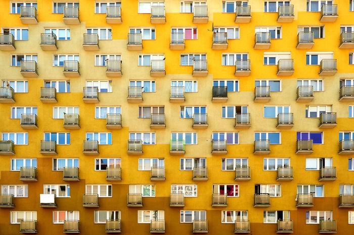 Full frame shot of orange residential building