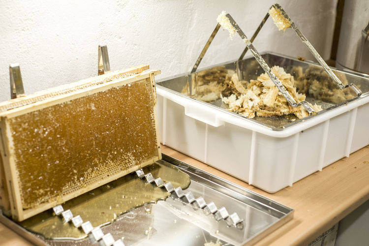 Honey Honeycomb Harvest Liquid Sweet Indoors  No People Still Life Container Food And Drink Food Close-up Table High Angle View Freshness Kitchen Utensil Household Equipment Sweet Food Wellbeing Domestic Room Home Interior Social Issues Dessert Tray Temptation