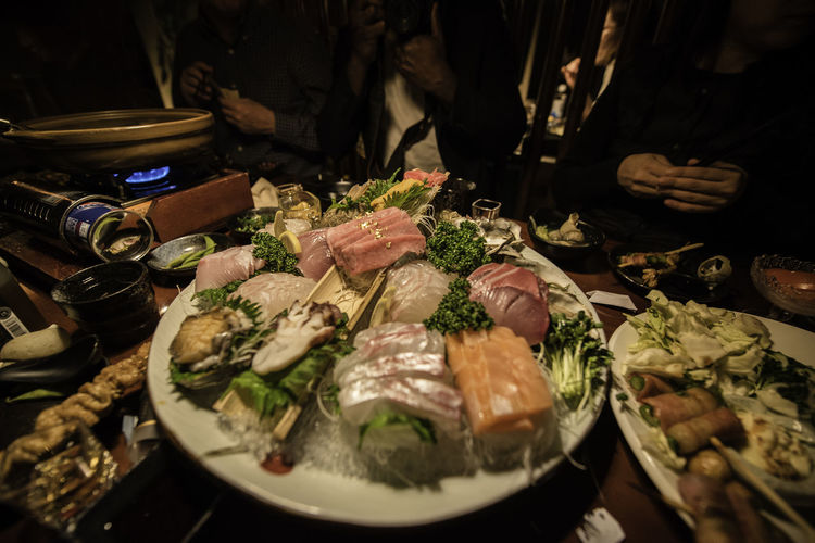 Japanese Izakaya Food And Drink Food Indoors  Plate Healthy Eating Wellbeing Restaurant People Close-up Seafood Japanese Food Fresh Food Oysters Izakaya Dinner Gettogether Eatingout Group Meal Asian Food Sashimi  Sashimi Dinner