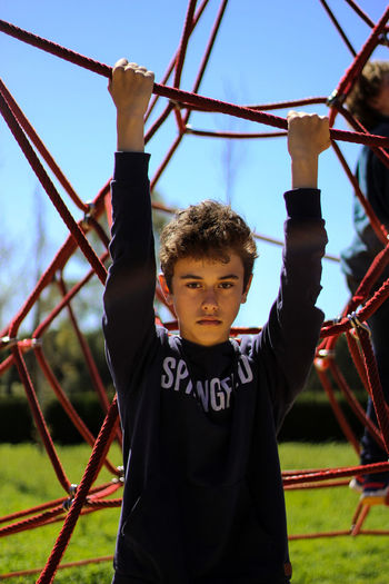 Boys Casual Clothing Childhood Clear Sky Day Front View Hanging Jungle Gym Leisure Activity Lifestyles One Person Outdoor Play Equipment Outdoors Park - Man Made Space People Playground Playing Real People Sky Springfield