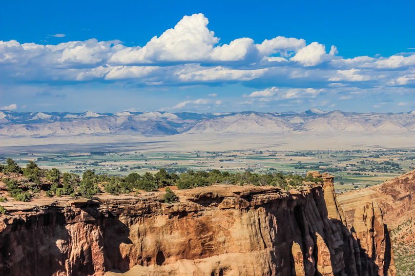 Colorado Colorado National Monument Fruita Geology Grand Junction Landscape Mountain Mountain Range Non-urban Scene Outdoors Physical Geography Rock Rock Formation Rock Formation Scenics Clouds Distance View Distance Blue Sky Blue Skies Co