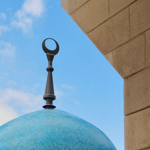 Low angle view of dome against clear blue sky
