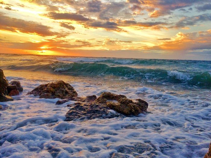 Sunset Sea Sky Beauty In Nature Water Scenics - Nature Wave Beach Cloud - Sky Horizon Over Water Land Motion Sport Orange Color Horizon Idyllic
