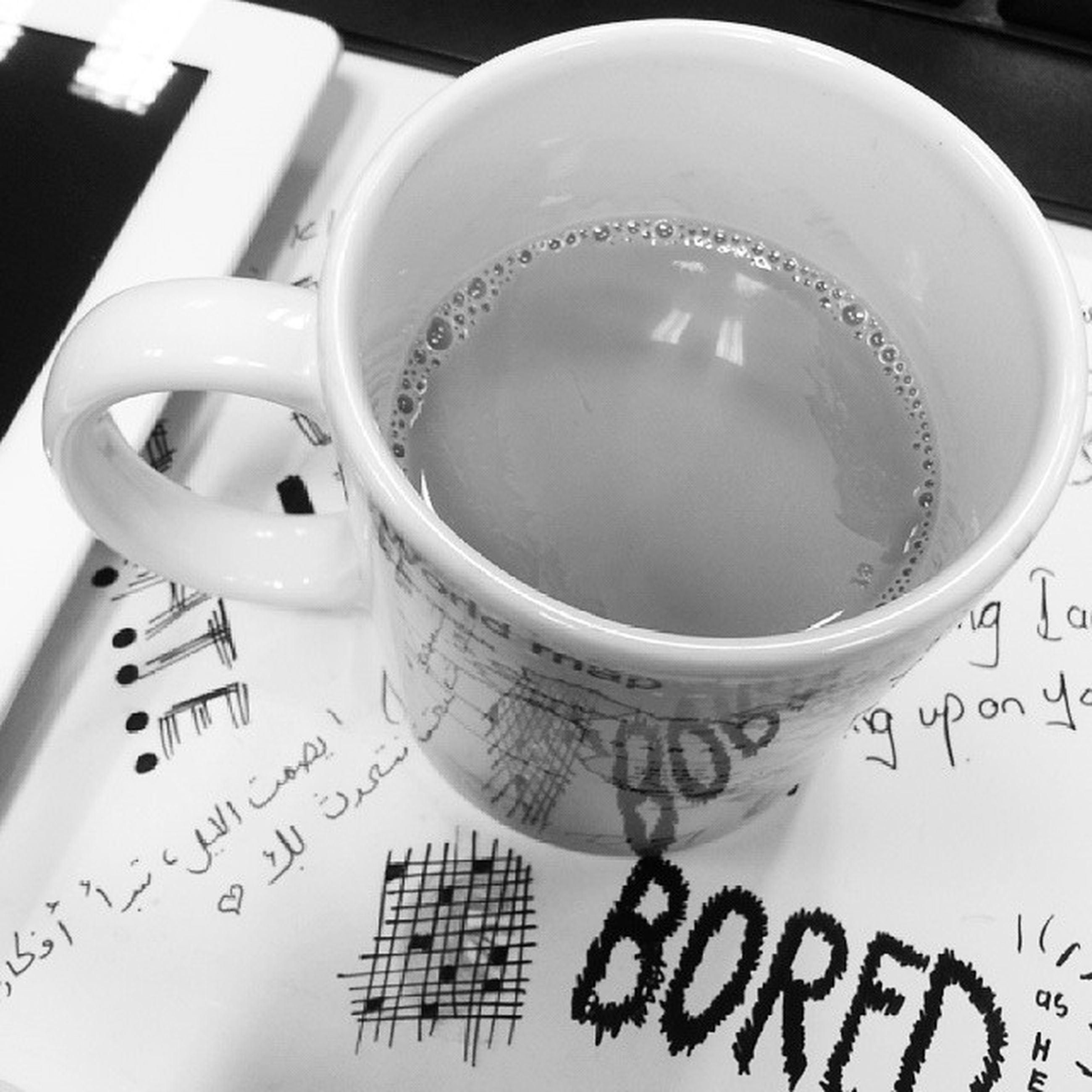 indoors, text, western script, communication, still life, close-up, table, coffee cup, paper, book, no people, education, drink, high angle view, technology, refreshment, number, studio shot, coffee - drink, selective focus