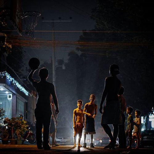 Boys play Basketball on a Street in Capitol site, Cebu city. Basketball is, undisputedly, the most Popular Sport in the archipelago where its population follows NBA Games with great Passion Photooftheday Picoftheday Instagood Travel Instatravel Wanderlust Urban Streetphotography Nightshot Itsmorefuninthephilippines Philippines ASIA Pinoy Iluvcebu Ubec iluvcebutravel igcebu Lumix GX7 followme
