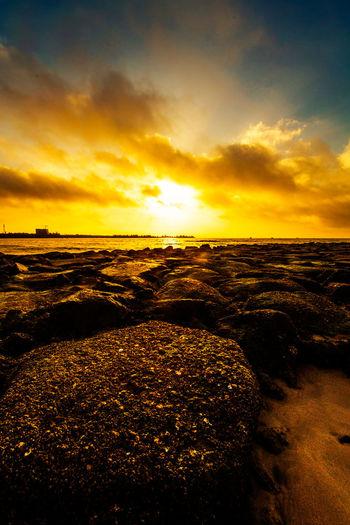 朝阳照亮礁石,兴起上去走走,谁知滑一大跤,血流满脚趾头。 rock Sunset Cloud - Sky Sea Beach Horizon Outdoors Dramatic Sky Rock