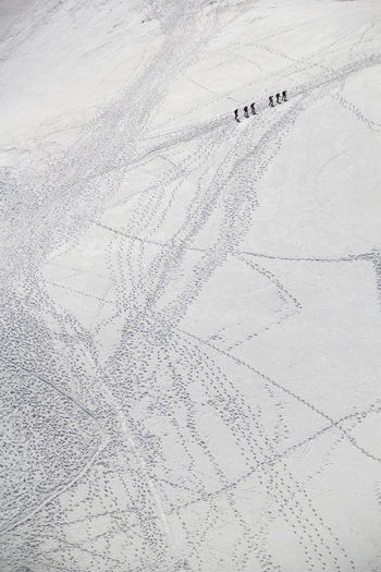 Aerial View Of Hikers Hiking On Snowcapped Mountain