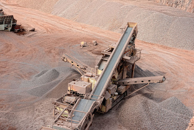 stone crusher in a quarry. mining industry Conveyor Belt Stone Crusher Mine Steinbrecher Minerals Mining Quarry Quarry Rock Stonepit Rocks Steinbruch Construction Material Construction Materials Production Transportation Stone Pit