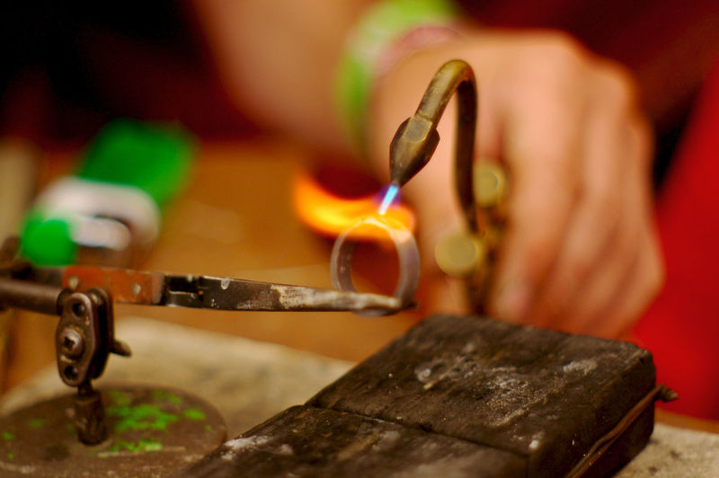 Jeweler Working At Her Workshop