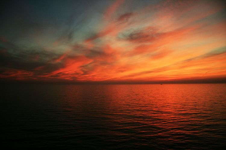 Sunset Sunset Red Rippled Water Reflection Beauty In Nature Nature Tranquility Cloud - Sky Outdoors No People Scenics