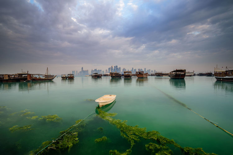 So lonely... Architecture Boat Built Structure City Cityscape Cloud Corniche Day Dhow Doha Dramatic Sky Guitar Gulf Landscape Nature No People Outdoors Qatar Reflection Sky Skyscraper Tranquility Tranquility Travel Destinations Water Neighborhood Map