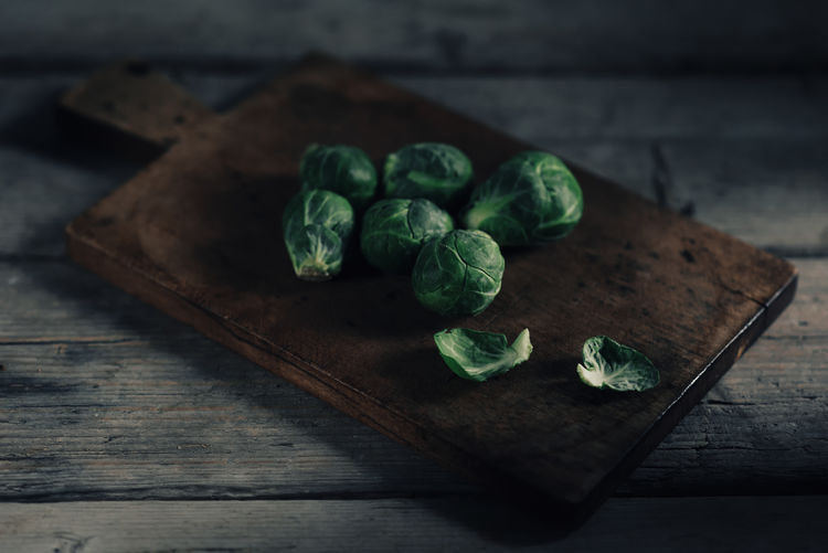High Angle View Of Brussels Sprout On Cutting Board