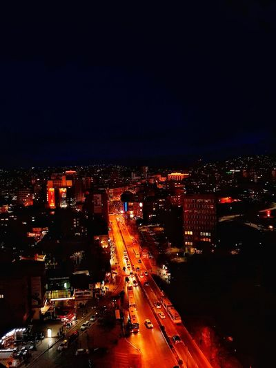 City Cityscape Illuminated Urban Skyline City Life Sky Building Exterior Architecture Multiple Lane Highway Headlight Light Trail Two Lane Highway Vehicle Tail Light Traffic Jam High Street Urban Road Overpass Viaduct Streetwise Photography