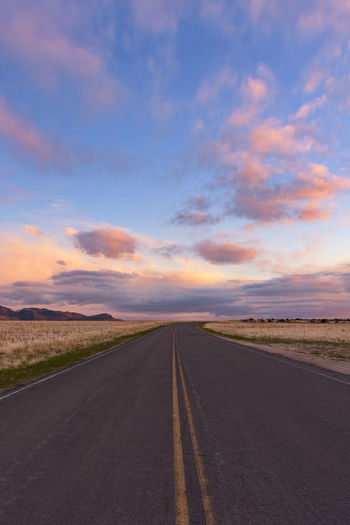 Down the Road Leading Lines Peace Sunset_collection Utah Asphalt Beauty In Nature Cloud - Sky Colorful Dividing Line Landscape Nature No People Outdoors Road Scenics Simplicity Sky Sunset Tranquil Scene Tranquility