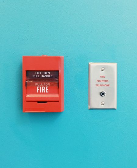 Fire alarm and fire fighters telephone plug hanging on the blue wall. Together Box Industrial Wall Blue Plugin Urgency Emergency Equipment SUPPORT Rescue Text Red Safety Fire Alarm Close-up No People Indoors  First Eyeem Photo