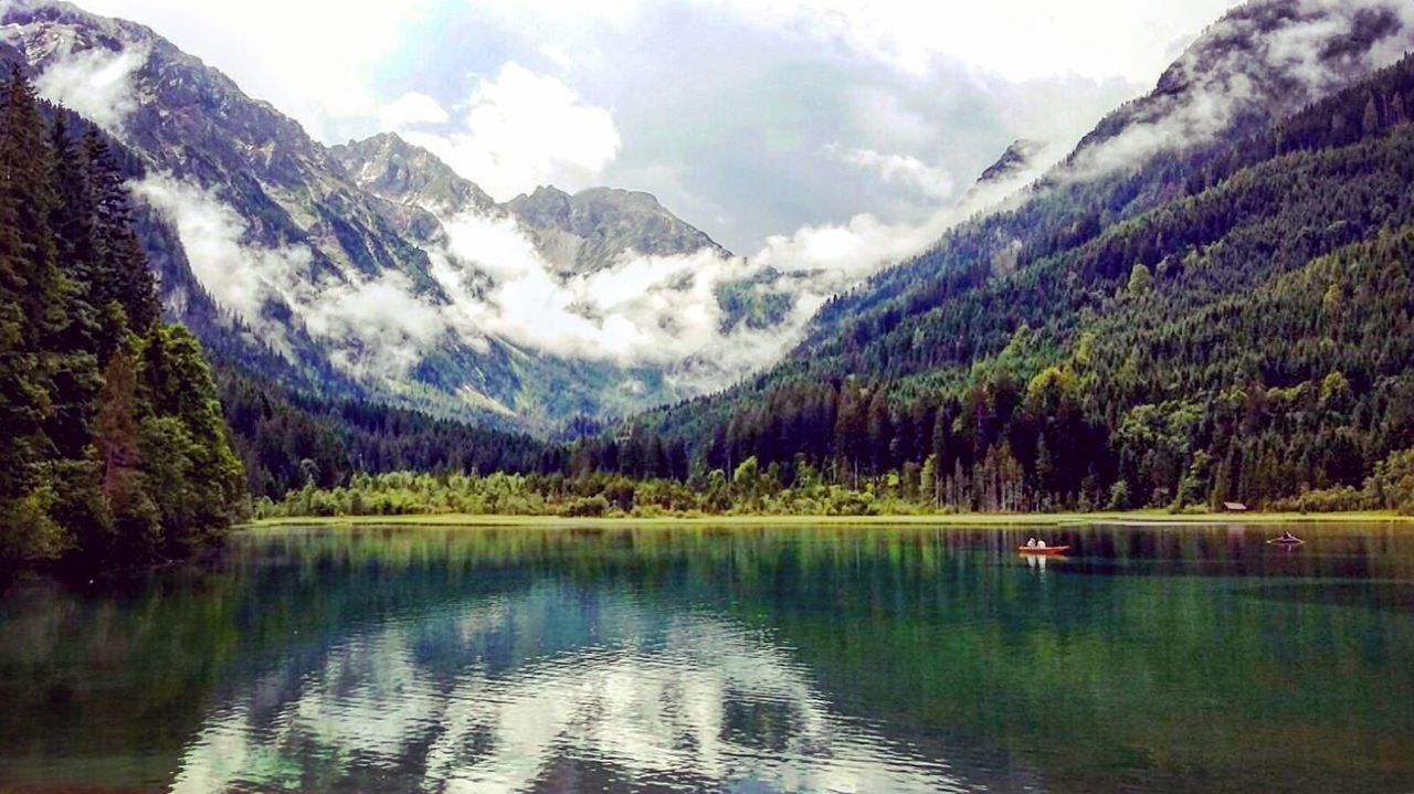 mountain, beauty in nature, reflection, nature, lake, scenics, tranquility, tranquil scene, water, idyllic, mountain range, wilderness, waterfront, snow, outdoors, sky, no people, day, landscape, scenery, cold temperature, tree, range