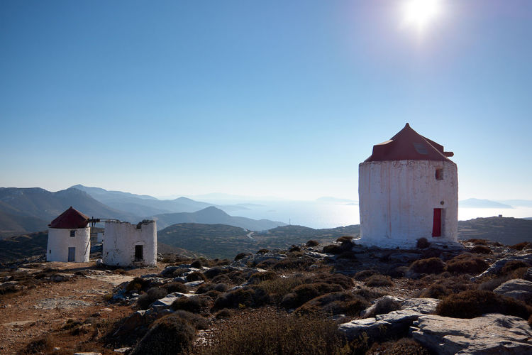 Amorgos Windmill Windmill Amorgos Architecture Belief Blue Building Building Exterior Built Structure Clear Sky Day Environment Greece Land Landscape Mountain Nature No People Outdoors Place Of Worship Religion Sky Spirituality Sunlight