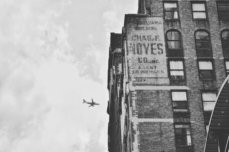 EyeEm Selects Flying Airplane Building Exterior Sky New York City New York Blackandwhite Black And White Nikon Let's Go. Together.
