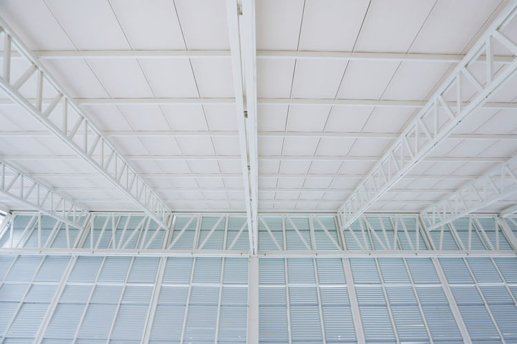 Large steel structure truss, roof frame and metal sheet in building construction site Architecture Built Structure No People Indoors  Ceiling Low Angle View Day Pattern Modern Full Frame White Color Backgrounds Architectural Feature Building Flooring Roof Design Glass - Material Large Steel Structure And Lines Truss Roof Rooftop Sheet Metal