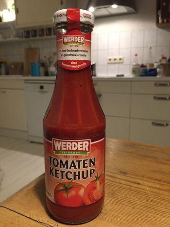 Berlin, Germany - January 31, 2018: Werder Tomaten ketchup. Since 1958, Werder is a German company specialized in the production of tomato ketchup and the processing of fruits and vegetables Cooking Diet Food And Drink Ingredients Spicy Werder Bottle Bottles Close-up Dieting Editorial  Focus On Foreground Food Food And Drink French Fries Freshness Indoors  Ingredient Ketchup Label No People Recipe Sauce Spice Tomato