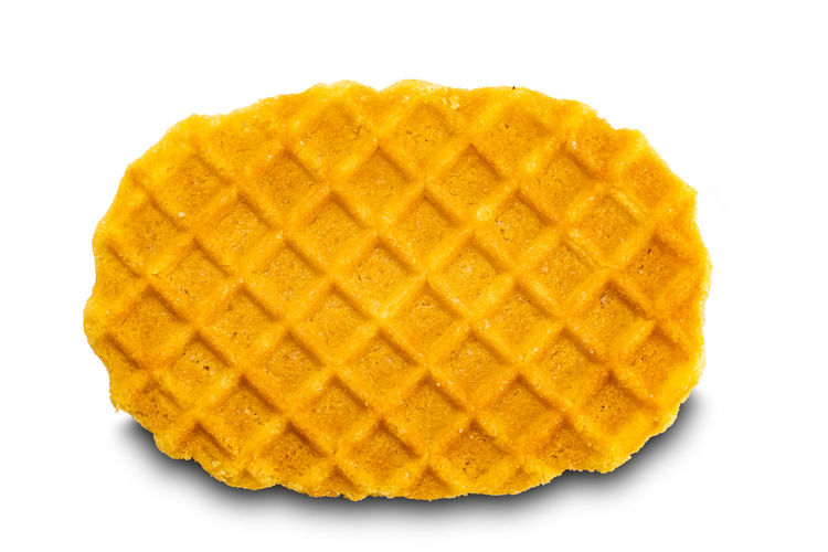 Close-up of yellow cake against white background