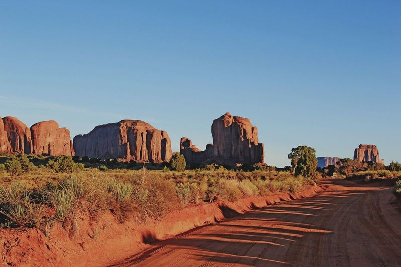 Monument Valley Mountains And Sky Mountain Range Sightseeing On The Way USA Travel Beauty In Nature Traveling Extreme Terrain Landscape Landscapes Nature Photography Nature Mountains Travel Destinations Mountain Rock Rock - Object Rock Formation Rocks Red Rocks  Sunset Dawn Dawn Of A New Day