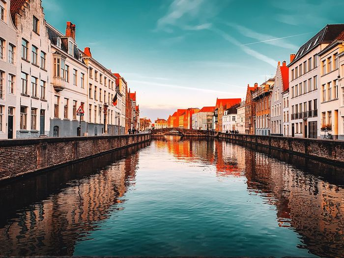 Bruges Reflections EyeEm Selects Architecture Building Exterior Built Structure Water Sky City Building Reflection River Row House