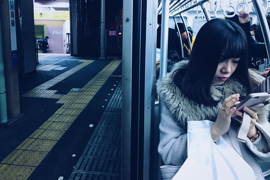 Japan Wireless Technology Communication Technology Text Messaging Mobile Phone Connection Portable Information Device Smart Phone Convenience Portability Looking Receiving Public Transportation Looking Down Holding Dialing Indoors  Transportation Commuter Internet Train