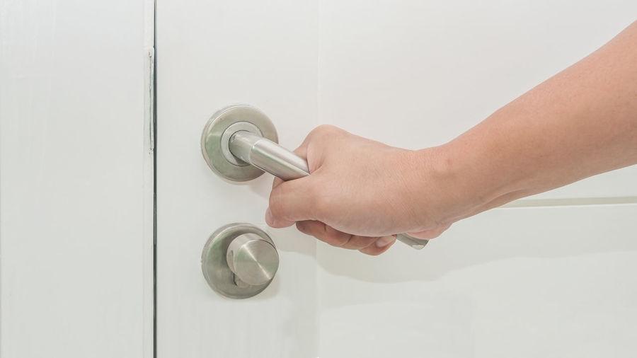 Close-up of hand holding doorknob