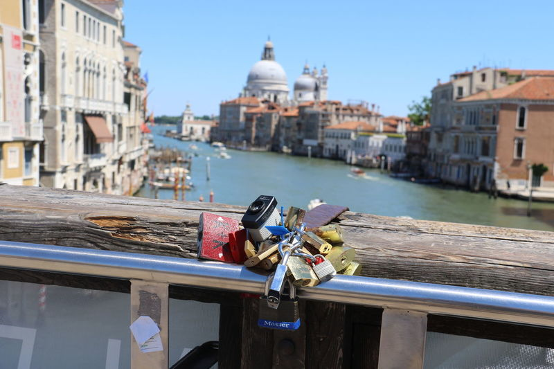 ALL OVER VENICE PEOPLE LEAVE THESE SYMBOLS OF LOVE Architecture Bridge - Man Made Structure Building Exterior Built Structure Canal City Clear Sky Close-up Day Dome Focus On Foreground Hope Lock Love Lock Nautical Vessel No People Outdoors Padlock Railing Spirituality Water The Week On EyeEm