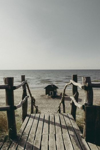 Sea Water Horizon Over Water Nature Scenics Pier Beach Clear Sky Wood - Material Outdoors Sky Beauty In Nature Tranquility No People Day The Week On EyeEm Your Ticket To Europe Beauty In Nature House On The Beach Sea And Sky Seaside Sky And Clouds The Week On EyeEm
