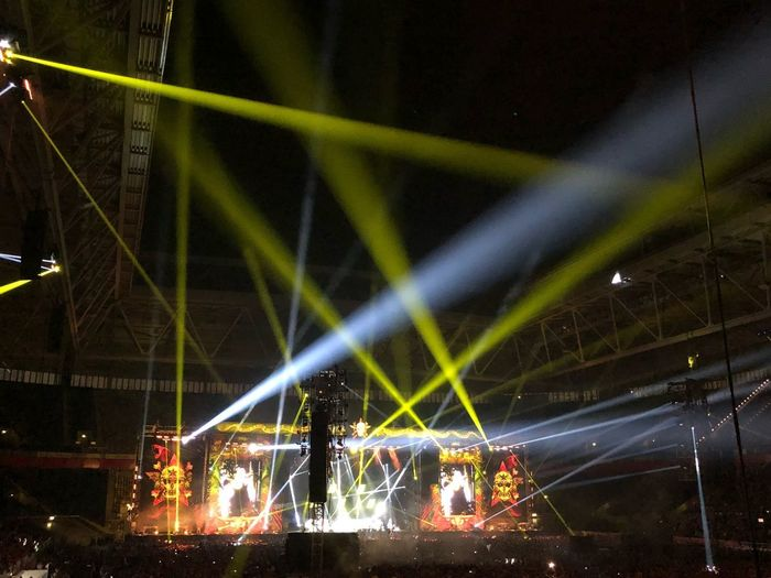 Night Illuminated Lighting Equipment Arts Culture And Entertainment Stage - Performance Space Performance Stage Light - Natural Phenomenon Event Nightlife Enjoyment Light Stage Light Built Structure Crowd Light Beam Popular Music Concert Music Glowing Architecture