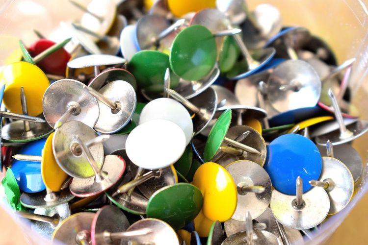 Close-up of multi colored thumbtack