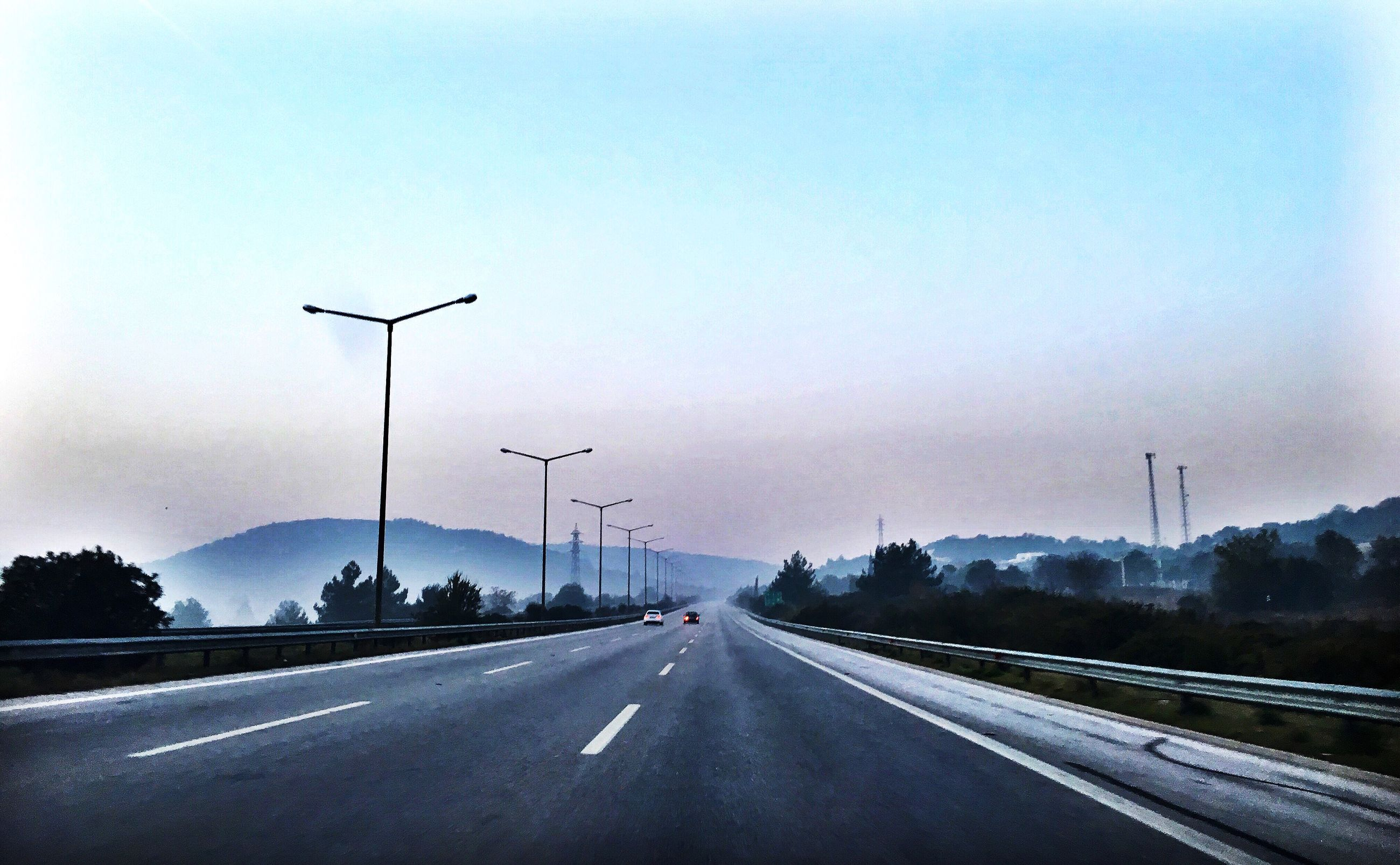 the way forward, road, transportation, street light, road marking, diminishing perspective, vanishing point, sky, empty, clear sky, street, copy space, empty road, car, lighting equipment, country road, road sign, outdoors, long, highway