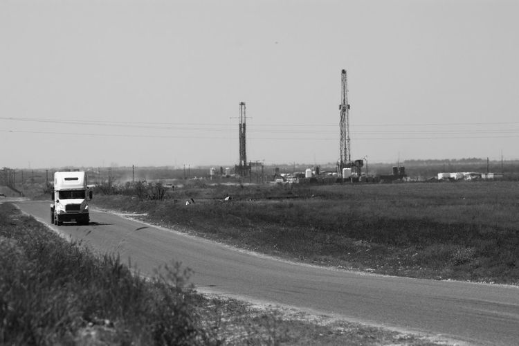 Clear Sky Day Driling Rigs Exploration Heat Shimmer Mode Of Transport Monochrome Photography Nature No People Oil Industry Outdoors Road Sky Texas Texas Landscape Transportation