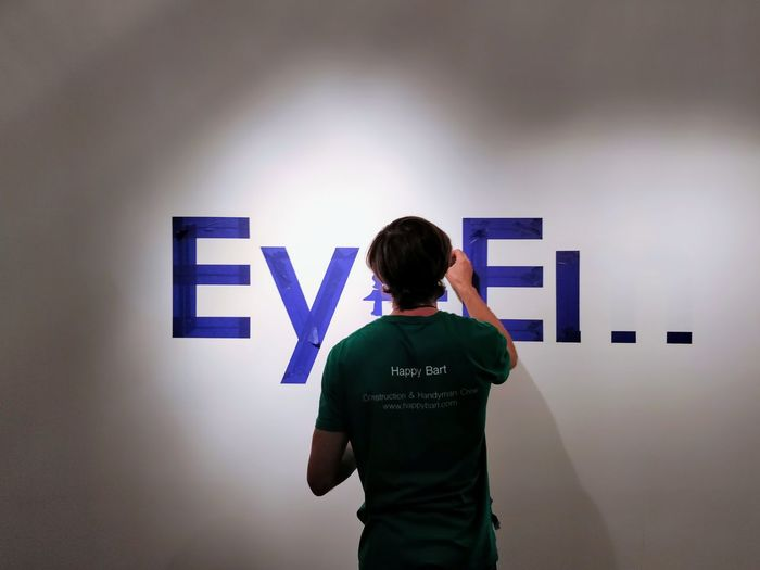 Something is happening... new logo? new color? Office Team EyeEm Logo Redesign Men Standing Occupation RISK Rear View Customer  Capital Letter Western Script Information