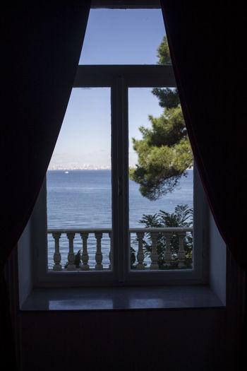 Sea seen through window of house