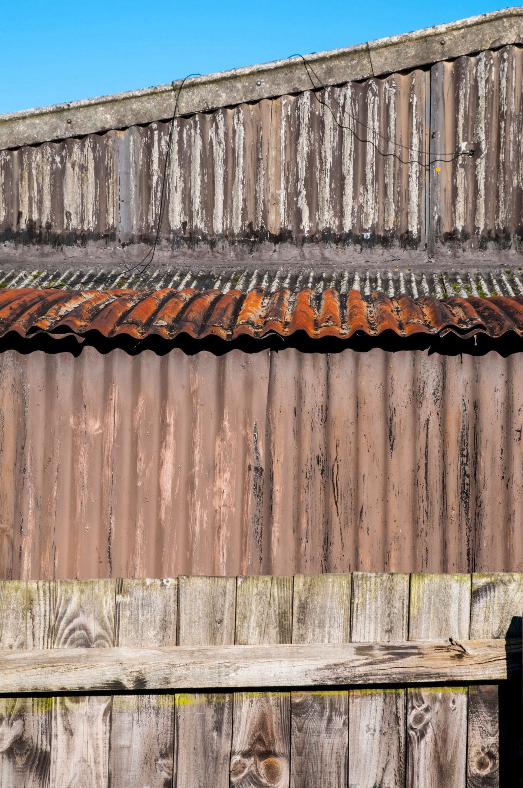 architecture, building exterior, built structure, low angle view, house, window, old, blue, brick wall, residential structure, building, wood - material, clear sky, wall - building feature, outdoors, day, door, residential building, facade, no people