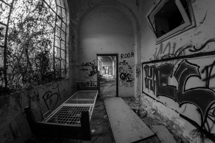 Mental Hospital  Architecture Graffiti Built Structure Building No People Wall - Building Feature Building Exterior Arch Day Seat Wall Empty Outdoors Old History Abandoned Absence Window Creativity Bench