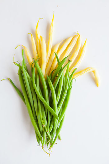 Fresh vegetables, green and yellow beans against a white background top view Freshness Studio Shot Food And Drink Food Indoors  Healthy Eating Wellbeing Vegetable Green Color Still Life White Background No People Raw Food Yellow High Angle View Close-up Directly Above Beauty In Nature Plant Cut Out