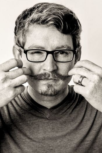 EyeEm Selects Real People Lifestyles One Person Portrait Looking At Camera Casual Clothing Eyeglasses  Studio Shot Young Adult Young Men White Background Close-up Mustache Hipster Hipster - Person Front View Photography Photographer Selfie ✌ Self Portrait Indoors  Blackandwhite Canon Facial Expression