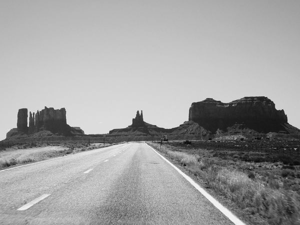 Clear Sky The Way Forward Road Copy Space Transportation Landscape Solitude Tranquil Scene Countryside Long Surface Level Remote Tranquility Outdoors Day Country Road Non-urban Scene Distant Vacations Leading Monument Valley Monumen Finding New Frontiers Traveling Home For The Holidays
