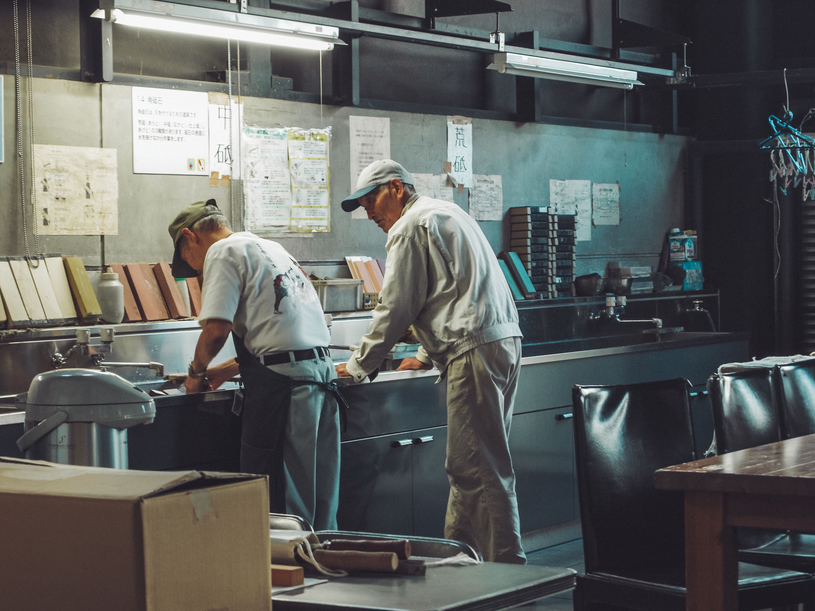 men, standing, real people, occupation, two people, indoors, business, people, males, working, preparation, adult, uniform, three quarter length, restaurant, teamwork, cooperation, table, casual clothing, kitchen, chef, preparing food